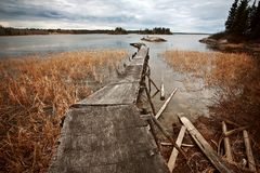 Dilapidated dock on Reed Lake in Northern Manitoba Royalty Free Stock Images