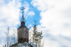 The dilapidated dome of old Orthodox Church. Dilapidated dome of old Orthodox Church against the cloudy sky Royalty Free Stock Photo
