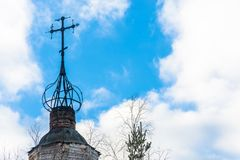 The dilapidated dome of old Orthodox Church. Dilapidated dome of old Orthodox Church against the cloudy sky Royalty Free Stock Photography