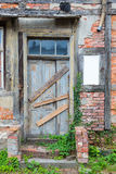 Dilapidated door in masonry house front Stock Image