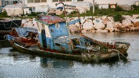 Dilapidated fishing boat lagos portugal. Wooden sinking dilapidated fishing boat in Lagos Portugal Stock Photos