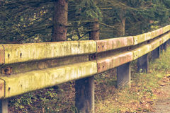 Dilapidated guardrail Stock Images