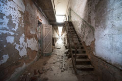Dilapidated hallway and stairs at Eastern State Penitentiary. A creepy hallway in Eastern State Penitentiary, Philadelphia Royalty Free Stock Photos