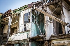 The dilapidated house. A dilapidated apartment building in the old districts of the city Royalty Free Stock Photography
