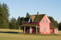 Dilapidated House in a Farmer's Field near Collapse Stock Photography