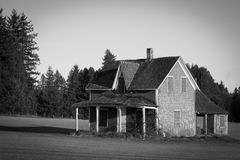 Dilapidated House in a Farmer's Filed Stock Photo