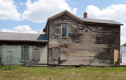 Dilapidated House. Old, dilapidated, historic house stands while rehab slowly takes place as part of urban renewal Stock Photography