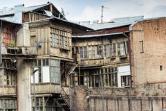 Dilapidated house with skewed balconies. Old skewed balcony in the Georgian ghetto Stock Photo