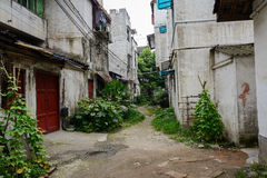 Dilapidated houses along unpaved alleyway Stock Photos