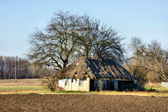 Dilapidated hut on the outskirts of the village Royalty Free Stock Photo