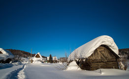 Dilapidated hut in winter Royalty Free Stock Photo