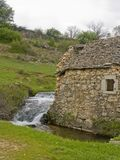 Ruin of an old mill in Croatia. Dilapidated idyllic mill with brook in the hinterland of Croatia Stock Photography