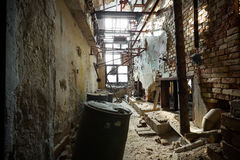Dilapidated industrial interior. An old dilapidated industrial interior, poor light stock photos