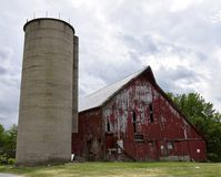 Dilapidated Kane County Barn. This is a Spring picture of a dilapidated old barn and cement silo lundera stormy sky ocated on a family farm located in Kane Stock Image