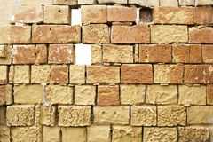 Dilapidated limestone wall. With missing bricks stock images