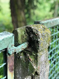 Dilapidated mental fence in the park. Dilapidated mental fence in park Royalty Free Stock Photography