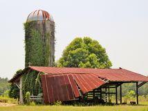 A dilapidated old barn and silo Royalty Free Stock Photo