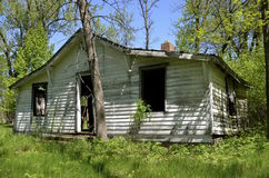 Dilapidated old house in the woods Royalty Free Stock Photo