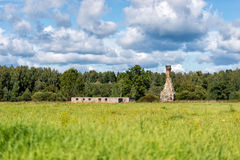 Dilapidated old houses and chimney. Rural landscape with dilapidated old houses and chimney Royalty Free Stock Photos