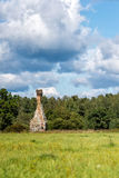 Dilapidated old houses and chimney. Rural landscape with dilapidated old houses and chimney Stock Image