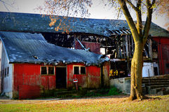 Dilapidated Old Red Barn. A dilapidated old red barn located in Walworth County in Lyons, Wisconsin Royalty Free Stock Photo