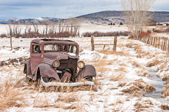 Dilapidated Old Vehicle. Rusty, dilapidated, abandoned vehicle in a field in rural America on a winter day stock photo