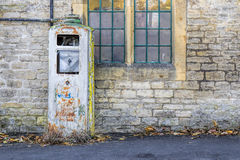 Dilapidated overgrown old petrol pump Stock Photography