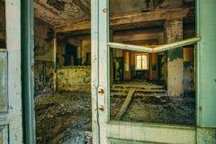 Dilapidated passage in school of Pripyat Stock Images