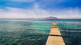Dilapidated Pier in the Sea Stock Images