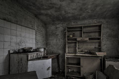 Dilapidated ramshackle kitchen in abandoned house Royalty Free Stock Photography