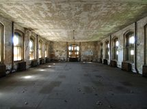 Dilapidated Room. A room waiting for renovation at historic Ellis Island National Park in New York Stock Photography
