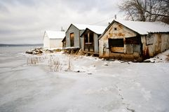 Dilapidated Rusted Sheds in the Snowy Winter royalty free stock image