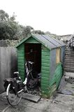 Dilapidated Shed. An old shed rotting away in the garden Royalty Free Stock Photo