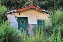 Dilapidated shed, small and abandoned Stock Photos