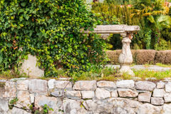 Dilapidated stone wall with bushes Royalty Free Stock Photo