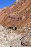 Dilapidated train tunnel on the aregentine Andes Mountain Range. Old and dilapidated train tunnel over abandoned roads in the Andes Mountains. Mendoza. Argentine stock photos
