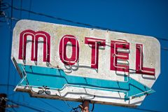 A dilapidated, vintage motel sign in the desert of Arizona. A dilapidated, classic, vintage motel sign in the desert of Arizona royalty free stock image