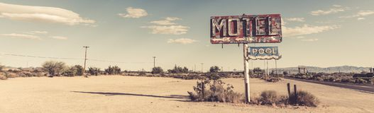 A dilapidated, vintage motel sign in the desert of Arizona. A dilapidated, classic, vintage motel sign in the desert of Arizona stock image