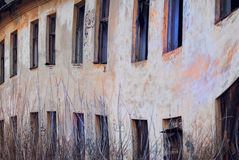 A dilapidated wall of abandoned barracks Stock Images