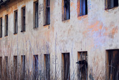 A dilapidated wall of abandoned barracks Royalty Free Stock Photo