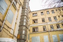 Dilapidated wall of an old high-rise building.  Stock Photography