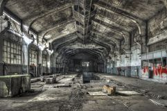 Dilapidated warehouse in an abandoned factory royalty free stock photos