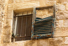 Dilapidated window in Old City Royalty Free Stock Images