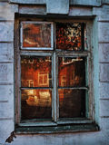 Dilapidated window reflects Red Royalty Free Stock Images