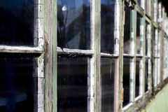 Dilapidated windows. Dilapidated rotten windows on derelict building awaiting demolition with shallow depth of field stock photos