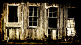 Dilapidated wooden building. Details of a dilapidated and abandoned wooden building.  Texture and color modified for antique appearance Royalty Free Stock Photos