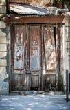 Dilapidated wooden door Royalty Free Stock Photos