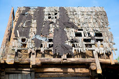 Dilapidated wooden leaky roof. Old wooden country house roof Royalty Free Stock Photo