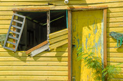 Dilapidated Yellow Building Stock Images