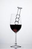 Dildo e vino Fotografia Stock
